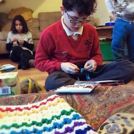 junior crochet class - boy crocheting